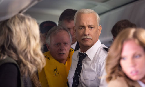 Sully tries to help passengers get off the downed plane
