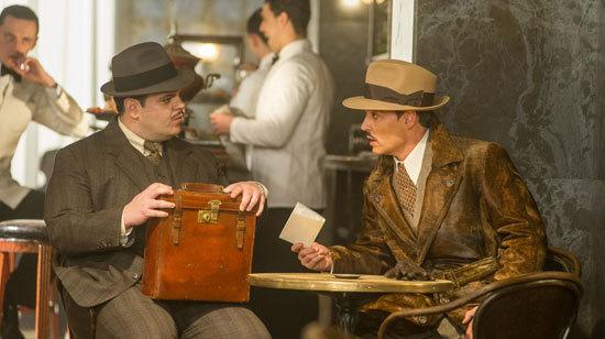 McQueen (Josh Gad) with boss Ratchett (Johnny Depp)