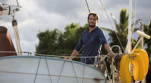 Richard sails the boat he built into port