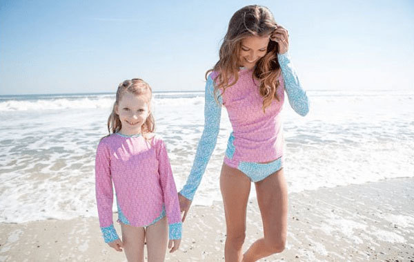 Rash guards with or without ultraviolet protection help block the sun's harmful ultraviolet rays