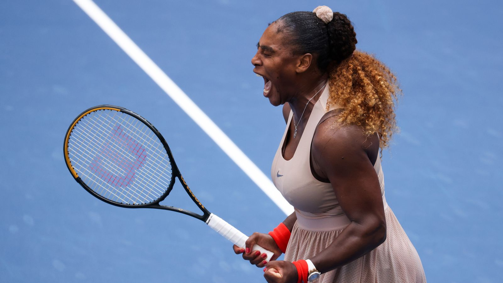 Williams battles back to reach