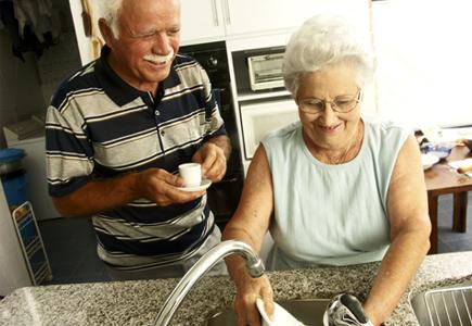 Older Couple at a Sink