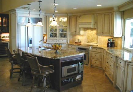 Kitchen with granite countertops and tumbled marble backsplash.