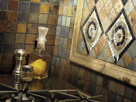 A stone tile kitchen backsplash from Crosville.