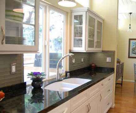Kitchen with glass cabinets and yellow walls.