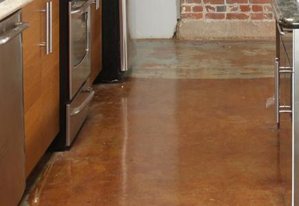 Concrete-Floor-In-Kitchen-With-Appliances