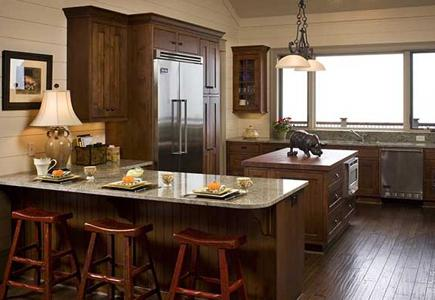 A Transitional kitchen with walnut flooring and alder cabinets