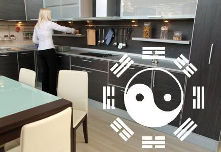 Woman in feng shui designed kitchen.