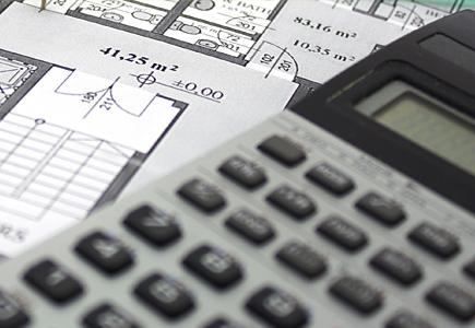 Close up of Calculator and Blueprints