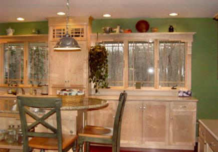 Kitchen with Shaker-style cabinets with natural stain and island with granite countertop