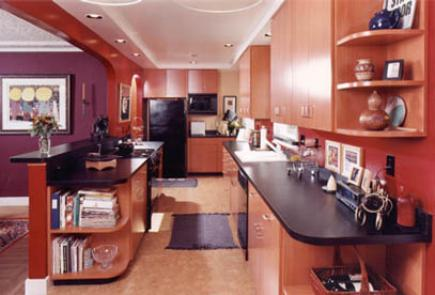 Kitchen with laminate floors and cabinetry.
