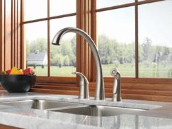 Stainless steel kitchen faucet with sidespray.