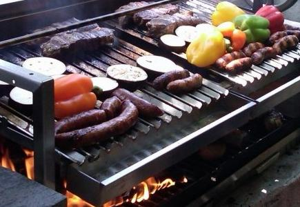 Grill with Sloped Grates Cooking Assorted Foods