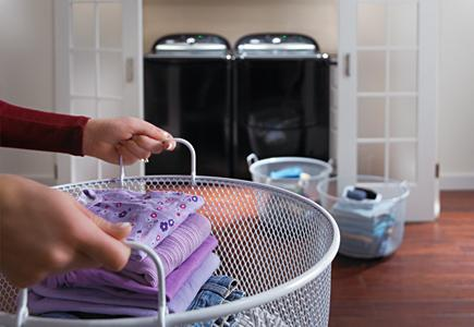 Hands-Carrying-A-Laundry-Basket