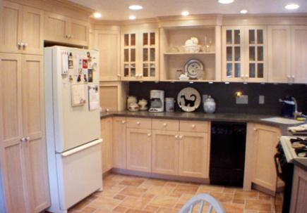 Kitchen with light wood Shaker style cabinets.