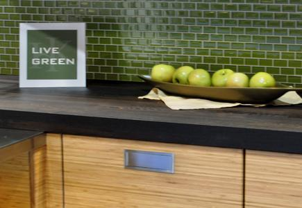 Eco-Friendly Wooden Cabinet with a bowl of apples on top