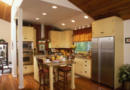 Kitchen with wood flooring and knocked-through wall