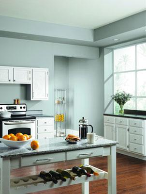 The pale blue walls in this kitchen jibe with 2012 color trends.