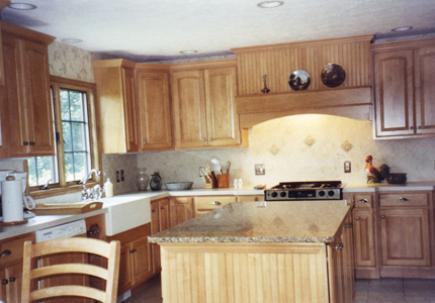 Kitchen with maple cabinetry and ceramic floor tile