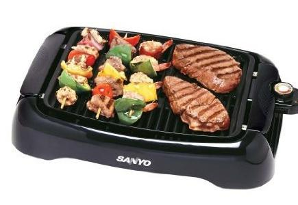 A Sanyo Grill with an assortment of food.