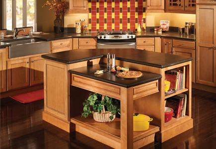 Light brown wood cabinets with central kitchen island