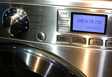 Close-Up-Of-Washer-Control-Panel-Display-And-Filter-Warning