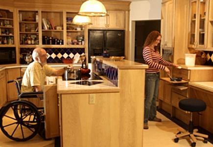 Man in wheelchair in accessible kitchen