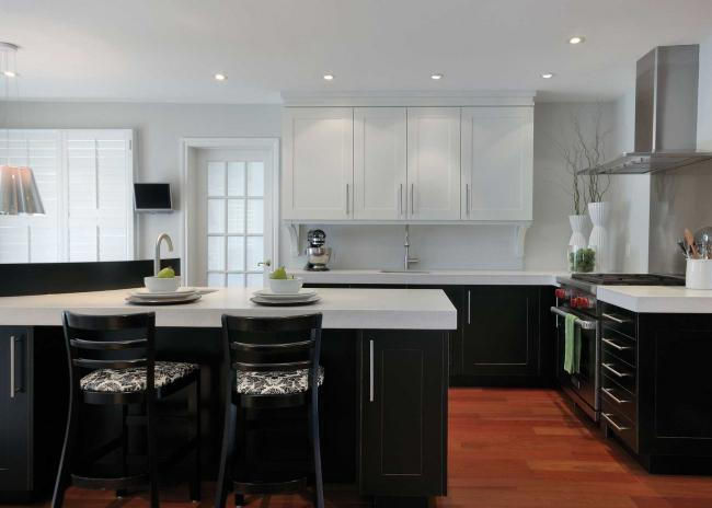 Small kitchen with dark brown and white cabinets and white Silestone countertops