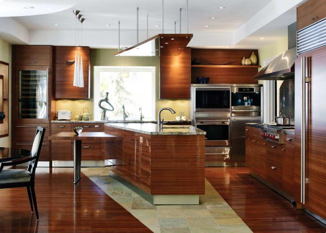 Large open kitchen with ribbon mahogany cabinetry, Sub-Zero and Wolf appliances, and granite countertops