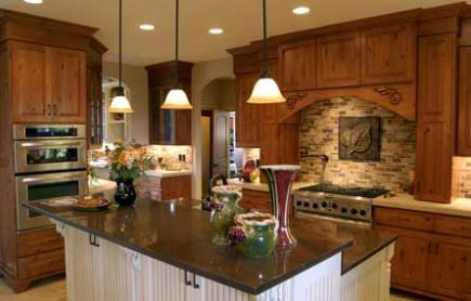 Kitchen with white island and three pendant lighting fixtures.