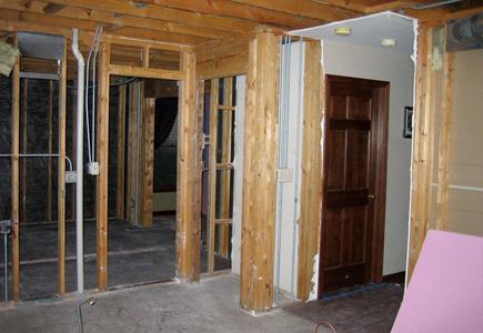 Picture of gutted kitchen with timbers exposed