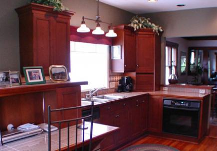 Kitchen with custom alder cabinets and granite tile countertops