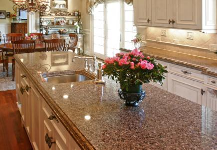 A kitchen with split-level stone countertops.