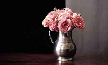 Match pewter vase with pink roses.