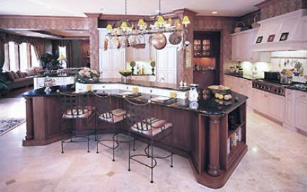 Large kitchen with cherry cabinets and white cabinets and a large island.
