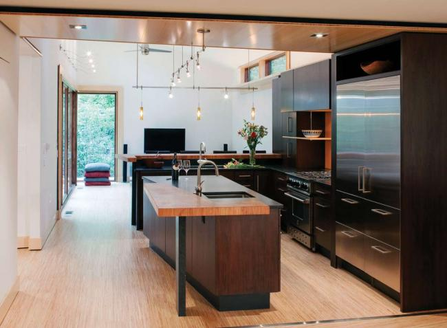 An eco-friendly kitchen with stainless steel appliances and a butcher block countertop