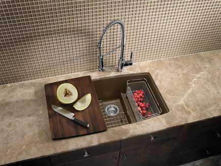 Granite kitchen sink with a high-arc faucet.