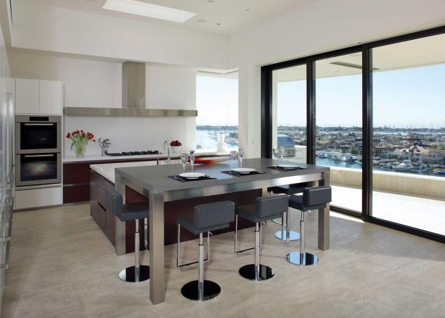 Contemporary kitchen with open floor plan leading to outdoor terrace
