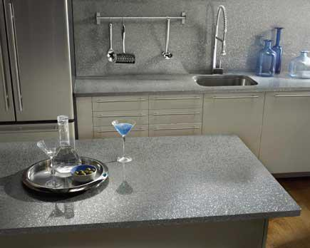 A contemporary kitchen with quartz countertops.