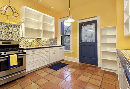 Kitchen with bright blue walls and brown cabinetry