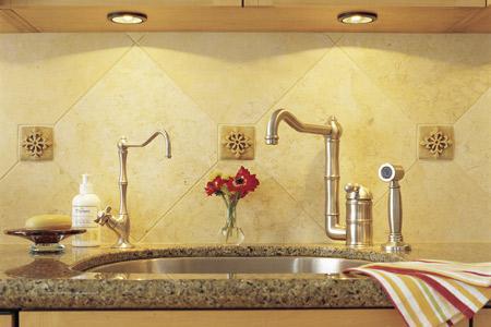 Kitchen sink with undercabinet lights overhead