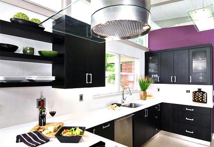 A Contemporary Kitchen With Dark Cabinetry and Aluminum ToeKick