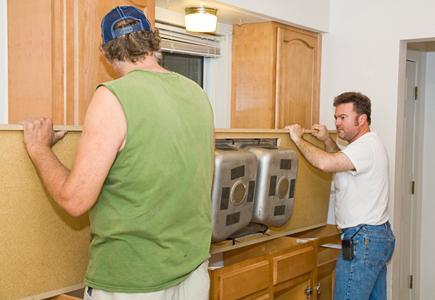 Two workmen installing a sink countertop