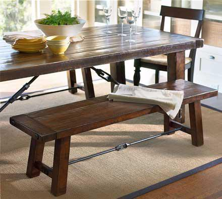 Wooden bench for seating at dining table.