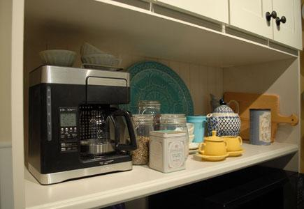 Coffee-Maker-And-Supplies-On-Kitchen-Counter