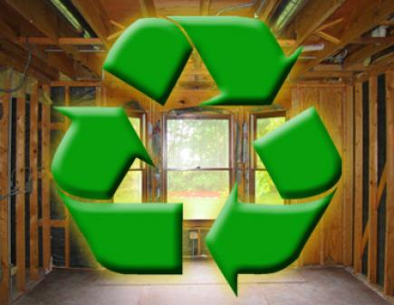 Recycling Symbol Superimposed Over Image of Kitchen