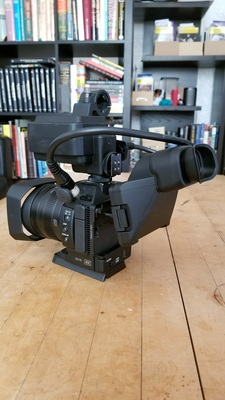 Canon xc15 with accessories mounted side