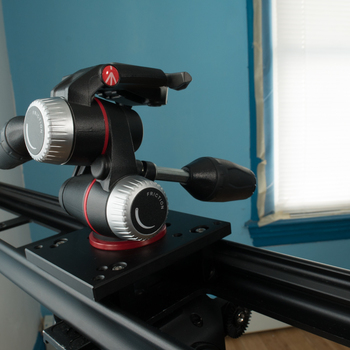 """Rent Motorized 48"""" Slyder Dolly Slider w/ Stabilizing Arm and Manfrotto Pan/Tilt Head"""