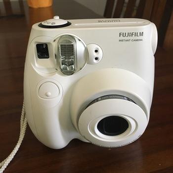 Rent Fujifilm Instax Mini 7S Polaroid-like camera with film.