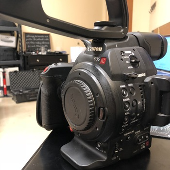 Rent Caon C100 Mark 2 with side grip and top handle.